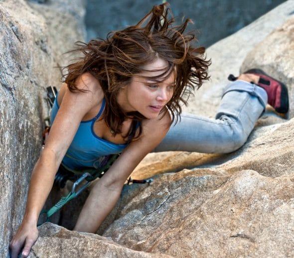 Photocase Jonge vrouw bergbeklimmen