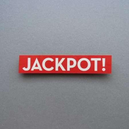 Jackpot! bordje tegen een grijze achtergrond